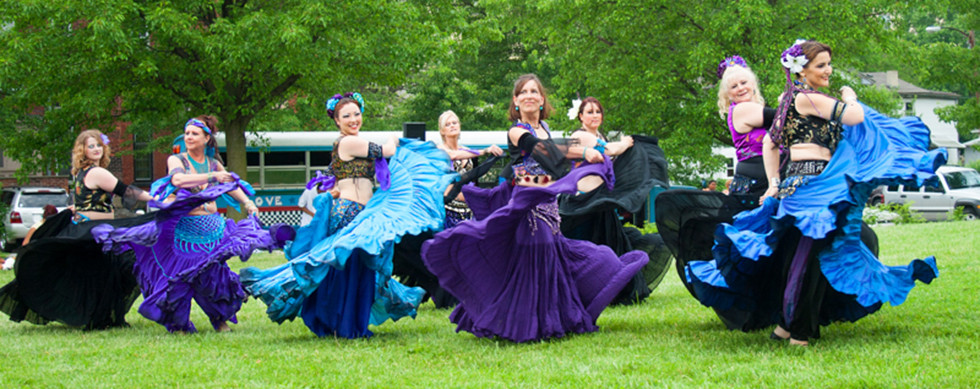 Group of belly dancers on the lawn from the Aegela Center for Middle Eastern Dance